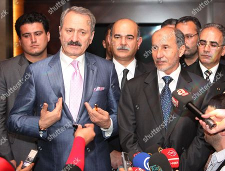Libya's National Transitional Council (tnc) Chairman Mustafa Abdel Jalil (r) and the Turkish Foreign Trade Minister Zafer Caglayan (l) Address a Joint Press Conference in Tripoli Libya 10 June 2012 According to Media Reports Caglayan Arrived in Libya on 10 June Inaugurate Several Buildings Which Were Constructed Or Repaired by Turkish Contractors Libyan Arab Jamahiriya Tripoli