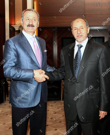 Libya's National Transitional Council (tnc) Chairman Mustafa Abdel Jalil (r) Shakes Hands with Turkish Foreign Trade Minister Zafer Caglayan (l) After Their Meeting in Tripoli Libya 10 June 2012 According to Media Reports Caglayan Arrived in Libya on 10 June Inaugurate Several Buildings Which Were Constructed Or Repaired by Turkish Contractors Libyan Arab Jamahiriya Tripoli