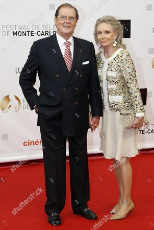 Sir Roger Moore and His Wife Christina Tholstrup Pose During the Opening Ceremony of the Monte Carlo Television Festival in Monaco 10 June 2012 Monaco Monte Carlo