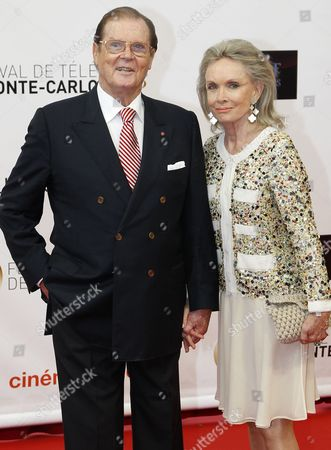 Stock Photo of Sir Roger Moore and His Wife Christina Tholstrup Pose During the Opening Ceremony of the Monte Carlo Television Festival in Monaco 10 June 2012 Monaco Monte Carlo