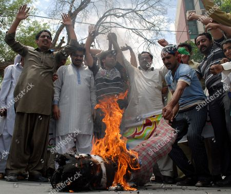 Supporters of Ruling Pakistan People Party Burn an Effigy of Supreme Court's Chief Justice Iftikhar Muhammad Chaudhry As They Shout Slogans After the Supreme Court Convicted the Prime Minister Yusuf Raza Gilani of Contempt in Multan Pakistan 26 April 2012 Pakistan's Supreme Court on 26 April Convicted Prime Minister Yousuf Raza Gilani of Contempt of Court Meaning He Cannot Hold Public Office But Imposed Only a Symbolic Punishment Ordered Him to Stay in the Courtroom As Punishment Until the Judges Left Gilani was Found Guilty For Failing to Write to the Swiss Authorities to Ask Them to Re-open Graft Cases Against President Asif Ali Zardari who Heads the Pakistan People's Party to Which Gilani Also Belongs Despite a Court Order to Do So Pakistan Multan