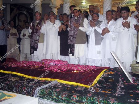Newly Elected Prime Minister Raja Pervez Ashraf (4-r) Prays at the Grave of Nusra Bhutto the Mother of Slain Former Prime Minister Benazir Bhutto During His Visit to the Mausoleum of Slain Former Prime Minister Benazir Bhutto in Gari Khuda Buksh Pakistan 24 June 2012 Pakistan's Parliament on 22 June Elected Raja Pervez Ashraf As the New Prime Minister Ending Days of Uncertainty After the Former Premier Yusuf Raza Gilani was Disqualified by the Supreme Court the Premiership Fell Vacant After Yousuf Raza Gilani was Disqualified by the Supreme Court on 19 June For Contempt of Court Following His Refusal to Write to the Swiss Government Asking For Graft Cases Against Zardari to Be Reopened Pakistan Gari Khuda Buksh