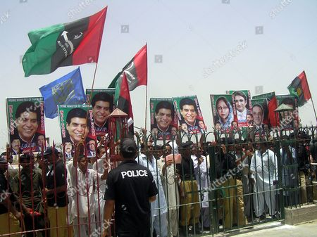 Supporters of Ruling Pakistan People Party Carry Portraits of Newly Elected Prime Minister Raja Pervez Ashraf During His Visit to the Mausoleum of Slain Former Prime Minister Benazir Bhutto in Gari Khuda Buksh Pakistan 24 June 2012 Pakistan's Parliament on 22 June Elected Raja Pervez Ashraf As the New Prime Minister Ending Days of Uncertainty After the Former Premier Yusuf Raza Gilani was Disqualified by the Supreme Court the Premiership Fell Vacant After Yousuf Raza Gilani was Disqualified by the Supreme Court on 19 June For Contempt of Court Following His Refusal to Write to the Swiss Government Asking For Graft Cases Against Zardari to Be Reopened Pakistan Gari Khuda Buksh
