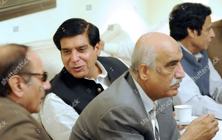 Raja Pervez Asharf who Has Been Nominated As One of the Leading Candidates For Prime Ministership by President Asif Ali Zardari Talks with Chaudhry Shujaat Hussain (l) Head of Coalition Party Pakistan Muslim League Quaid (pml-q) As Syed Khurshid Shah (2 R) Another Leader of Ruling Pakistan People Party Looks on in Islamabad Pakistan 21 June 2012 the Party and Its Coalition Allies Hold a Comfortable Majority in Parliament Making Ashraf the Likely Winner Among the Five Registered Candidates in the National Assembly's Vote Scheduled For Later Friday the New Prime Minister Will Replace Ousted Yousuf Raza Gilani Disqualified by a Conviction For Contempt of Court Pakistan Islamabad