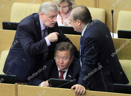 Sergei Mironov (l) a Leader of Just Russia Opposition Party of the State Duma (lower House of Parliament) Talks to His Party Deputies Whilst Debating an Anti-protest Law in Moscow Russia 05 June 2012 the New Law Includes Proposals For a Hike in Fines For Anyone Found Organising Unauthorised Rallies Or Protests Russian Federation Moscow