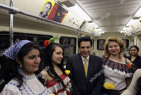 Stock Picture of The Ambassador of Colombia in Russia Rafael Francisco Amador Campos (c) Poses For Pictures with National Columbian Dancers Inside the Moscow Metro Train with the Exhibition 'Poetry and Prose of Gabriel Garcia Marquez' in Moscow Russia 25 April 2012 a Metro Train Devoted to Poetry and Prose of Colombian Writer Gabriel Garcia Marquez was Launched in the Moscow Subway on Initiative on 25 April of the Colombian Ambassador in Russia Russian Federation Moscow