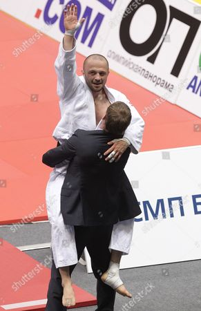 Alim Gadanov of Russia (white) Celebrates His Victory Against Tomasz Kowalski of Poland During Their Men's - 66 Kg Final Match at the European Judo Championships at the Traktor Arena in Chelyabinsk Russia 26 April 2012 Russian Federation Chelyabinsk
