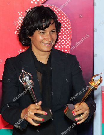 British Film Director Tinge Krishnan Poses For Media with Main Prize the 'Golden George' After She Received the Award For the Film 'Junkhearts' During the Closing Award Ceremony of the 34th Moscow Film Festival at 'Oktyabr' Concert Hall in Moscow Russia 30 June 2012 Russian Federation Moscow