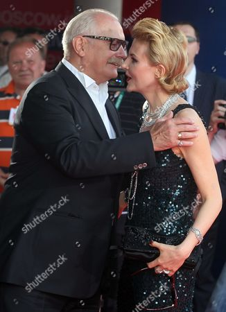 President of the 34th Moscow Film Festival Nikita Mikhalkov (l) Greets Russian Actress Renata Litvinova (r) As They Arrive For the Opening Ceremony of the 34th Moscow Film Festival at 'Oktyabr' Concert Hall in Moscow Russia 21 June 2012 the Festival Runs From 21 to 30 June Russian Federation Moscow