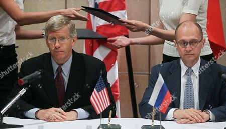 Us Department of Energy Deputy Secretary Daniel Poneman (l) and State Atomic Energy Corporation 'Rosatom' Director General Sergei Kiriyenko (r) Attend a Signing Ceremony of an Agreement on the Conversion of Research Nuclear Reactors From High-enriched to Low-enriched Uranium Fuel Between Russia and Usa During the Bilateral Presidential Commission's Nuclear Energy and Nuclear Security Working Group Session in Moscow Russia 26 June 2012 Russia and Usa Signed an Intergovernmental Agreement For Scientific and Technical Cooperation in the Field of Peaceful Atomic Energy in Autumn 2012 Sergei Kiriyenko Said Russian Federation Moscow