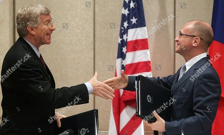 Us Department of Energy Deputy Secretary Daniel Poneman (l) Exchanges the Documents with State Atomic Energy Corporation 'Rosatom' Director General Sergei Kiriyenko (r) During a Signing an Agreement on the Conversion of Research Nuclear Reactors From High-enriched to Low-enriched Uranium Fuel Between Russia and Usa During the Bilateral Presidential Commission's Nuclear Energy and Nuclear Security Working Group Session in Moscow Russia 26 June 2012 Russia and Usa Signed an Intergovernmental Agreement For Scientific and Technical Cooperation in the Field of Peaceful Atomic Energy in Autumn 2012 Sergei Kiriyenko Said Russian Federation Moscow