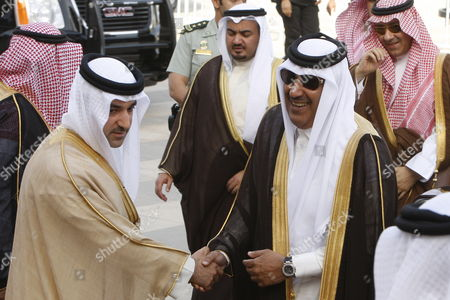 Qatari Prime Minister and Foreign Minister Sheikh Hamad Bin Jassim Jabr Al-thani (2-r) Arrives to Attend the Gulf Cooperation Council (gcc) Foreign Ministers Meeting in Riyadh 13 May 2012 Gulf Arab Leaders Are to Discuss Closer Ties Among Their States Especially Between Saudi Arabia and Bahrain They Will Also Discuss Progress in Their Overall Cooperation Since Their Summit in December 2011 when Saudi Arabian King Abdullah Bin Abdul Aziz Urged For a 'Transition From the Stage of Cooperation to the Union' Saudi Arabia Riyadh