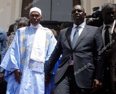 Macky Sall (r) Walks with Former Senegalese President Abdoulaye Wade (l) After Being Sworn in As President of Senegal at a Ceremony in Dakar Senegal 02 April 2012 Over 2 000 Dignitaries Witnessed Macky Sall Being Sworn in As the New President of Senegal Becoming the Country's First New Leader in 12 Years Former President Abdoulaye Wade Accepted Defeat and was in Support of Macky Sall Senegal Dakar