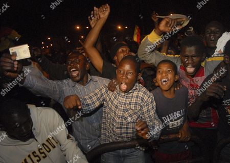 Senegalese Celebrate the Victory of Macky Sall in the Presidential Election Run-off in Dakar Senegal 26 March 2012 Senegal's President Abdoulaye Wade Has Conceded Defeat and Congratulated His Rival Macky Sall After Initial Results Showed Sall Had Won Sunday's Election by a Majority According to State Broadcaster Rts Wade Telephoned Sall His Former Prime Minister at About 9:30 Pm (2130 Gmt) to Congratulate Him on His Victory at That Time Sall Had About 30 000 Votes to Wade's 11 000 Rts Reported Outside Sall's Party Headquarters Thousands of People Gathered to Celebrate They Danced Through the Streets Setting Off Fireworks and Singing Some Clambered Onto the Roofs of Taxis and Waved Posters of Sall in the Air Senegal Dakar