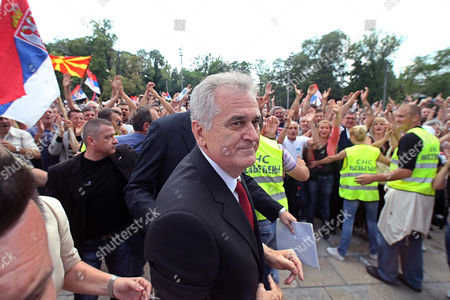 Serbian President-elect Tomislav Nikolic (c) Arrives at Serbia's Parliament in Belgrade Serbia 31 May 2012 Prior to a the Parliament's Inaugural Session Wuring Which New Members of Parliament Will Be Verified the Inaugural Session Will Be Followed by Another Ceremony During Which President-elect Tomislav Nikolic Will Take the Oath of Office Nikolic Unexpectedly Defeated Two-time President Boris Tadic in a Presidential Run-off Vote on 20 May 2012 Serbia and Montenegro Belgrade
