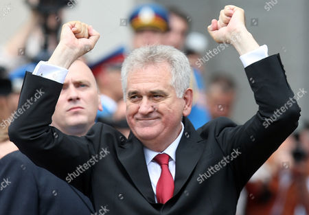 Seerbian President-elect Tomislav Nikolic Jubilates in Front of Serbia's Parliament in Belgrade Serbia 31 May 2012 Prior to a the Parliament's Inaugural Session Wuring Which New Members of Parliament Will Be Verified the Inaugural Session Will Be Followed by Another Ceremony During Which President-elect Tomislav Nikolic Will Take the Oath of Office Nikolic Unexpectedly Defeated Two-time President Boris Tadic in a Presidential Run-off Vote on 20 May 2012 Serbia and Montenegro Belgrade