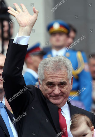 Serbian President-elect Tomislav Nikolic Waves Upon His Arrival at Serbia's Parliament in Belgrade Serbia 31 May 2012 Prior to a the Parliament's Inaugural Session Wuring Which New Members of Parliament Will Be Verified the Inaugural Session Will Be Followed by Another Ceremony During Which President-elect Tomislav Nikolic Will Take the Oath of Office Nikolic Unexpectedly Defeated Two-time President Boris Tadic in a Presidential Run-off Vote on 20 May 2012 Serbia and Montenegro Belgrade