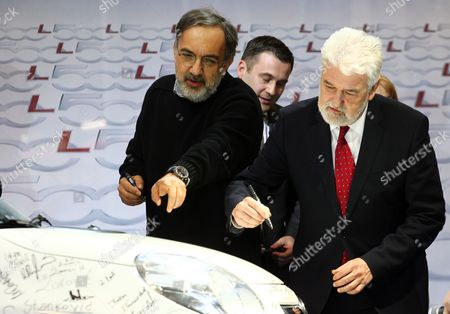 Stock Image of Sergio Marchionne (l) Ceo of Fiat Group and Serbian Prime Minister Mirko Cvetkovic (r) Sign the Bonnet of a Fiat Car During the Inauguration of a New Factory in Kragujevac Serbia 16 April 2012 Fiat Has Opened a Production Line in Serbia For Its New 500l Family Model to Expand on the Popularity of Its Two-door 500 City Car Serbia and Montenegro Kragujevac