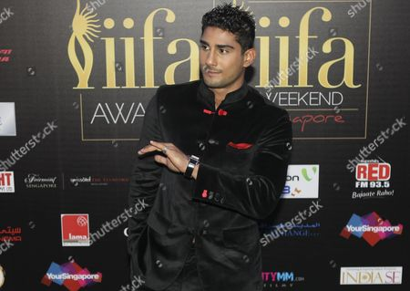 Stock Photo of Bollywood Actor Prateik Babbar Poses on the Green Carpet Before the International Indian Film Academy (iifa) Awards in Singapore 09 June 2012 the 13th Iifa Often Referred to As the Bollywood Oscars Celebrates the International Nature of Indian Cinema and is Held in a Different Country Outside of India Each Year Singapore Singapore