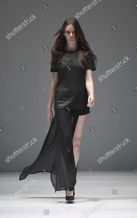 A Model Presents a Creation by German Designer Esther Perbandt During the Audi Fashion Festival in Singapore 17 May 2012 the Audi Fashion Festival Runs From 16-20 May 2012 Along Orchard Road in Singapore's Shopping District Singapore Singapore