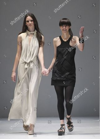 German Designer Esther Perbandt (r) with a Model Wearing One of Her Designs Acknowledges the Audience Following Her Show During the Audi Fashion Festival in Singapore 17 May 2012 the Audi Fashion Festival Runs From 16-20 May 2012 Along Orchard Road in Singapore's Shopping District Singapore Singapore