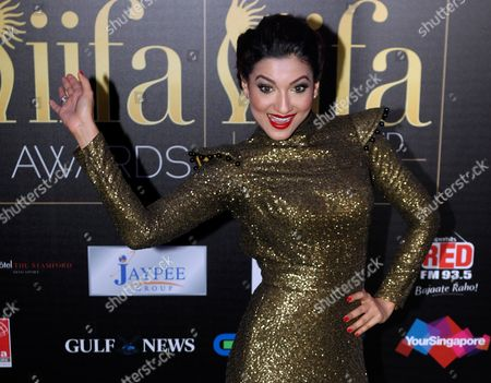 Bollywood Actress Gauhar Khan Poses on the Green Carpet Before the International Indian Film Academy (iifa) Awards in Singapore 09 June 2012 the 13th Iifa Often Referred to As the Bollywood Oscars Celebrates the International Nature of Indian Cinema and is Held in a Different Country Outside of India Each Year Singapore Singapore
