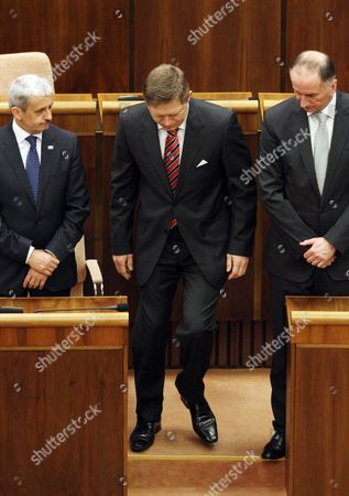 Outgouing Slovak Ministers Mikulas Dzurinda (l) of Foreign Affairs and Eugen Jurzyca (r) of Education with the Slovak Prime Minister-elect and Leader of the Smer Social Democracy Party Robert Fico (c) As He Walks to Take the Oath on the Slovak Constitution During the Constitutional Session of the New Slovak Parliament in Bratislava on 04 April 2012 Slovakia (slovak Republic) Bratislava