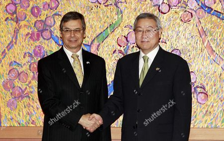 Stock Image of Israel's Deputy Foreign Minister Danny Ayalon (l) Shakes Hands with Kim Sung-hwan (r) Minister of Foreign Affairs and Trade at the Ministry of Foreign Affairs and Trade in Seoul South Korea 26 July 2012 Korea, Republic of Seoul
