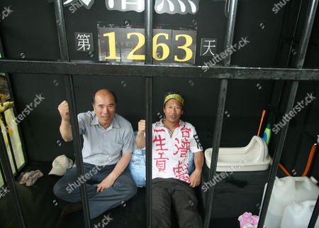 Two Supporters of Ex-president Chen Shui-bian Lock Themselves Inside a Fake Jail on a Street in Taipei Taiwan 12 May 2012 Demanding Taiwan's President Ma Ying-jeou to Pardon Chen who is Serving a 17-and-a-half-year Jail Term For Corruption Chen Advocates Taiwan Independence and His Supporters Call His Imprisonmen Pollitical Persecution by China-friendly President Ma Ying-jeou Taiwan Taipei