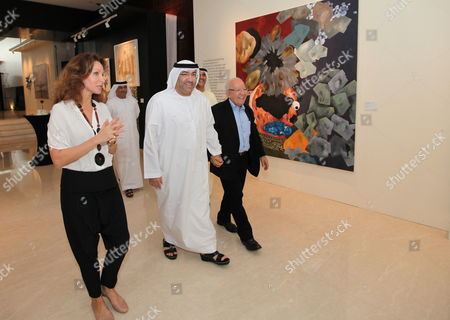 (l-r) Isabelle De La Bruyere Christie's Director Middle East Uae Minister of Culture Youth and Community Development Abdul Rahman Al Owais and the Internationally Recognized Tunisian Artist Nja Mahdaoui Tour During the Christie's Exhibition Held at Jumairah Emirates Towers in Gulf Emirate of Dubai United Arab Emirates 15 April 2012 the Auction For Modern and Contemporary Arab Iranian and Turkish Arts Will Be Held at the Jumeirah Emirates Towers Hotel on 17 and 18 April 2012 United Arab Emirates Dubai