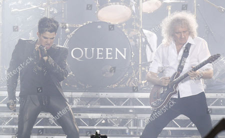 Stock Photo of British Guitarist Brian May and Us Singer Adam Lambert of British Rock Band Queen Performs at the Uefa Euro 2012 Fan Zone During a Grand Charity Concert Dedicated to the Fight Against Hiv/aids in Kiev Ukraine 30 June 2012 Ukrainian Elena Pinchuk Antiaids Foundation As Well As Colleagues in Fighting Aids Musicians Elton John and Queen with Adam Lambert Organized a Charity Concert in Kiev to Say: 'Your Life is not a Game! Let's Stop Aids Together' Ukraine Kiev