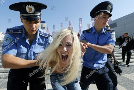 Ukrainian Policemen Arrest Activists of the Ukrainian Feminist Group Femen During Their Protest in Front of the Olympic Stadium in Kiev Ukraine 01 July 2012 Femen Activists Had Undressed in Public to Protest Against Possible Arrival of Belarusian President Aleksandr Lukashenko For Final Game Italy Vs Spain and a Rise in Prostitution During the Uefa Euro 2012 Soccer Championship in Ukraine Ukraine Kiev