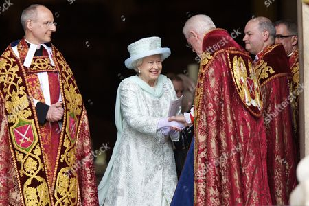 Britain's Queen Elizabeth Ii (c) Leaves the National Service of Thanksgiving to Celebrate Queen Elizabeth Ii's Diamond Jubilee As Dean of St Paul's David Ison (l) Looks on at St Paul's Cathedral in London Britain 05 June 2012 This is the Final Day of the Diamond Jubilee Central Weekend Celebrating Queen Elizabeth Ii's 60 Years on the Throne United Kingdom London