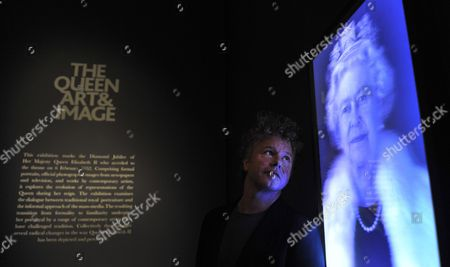 British Artist Chris Levine Looks Over His 'Equanimity' Lenticular Image of Britain's Queen Elizabeth Ii at the National Portrait Gallery in London Britain 16 May 2012 the 3d Holographic Image is Part of the Exhibition of Images of the Queen From Over 60 Years of Her Reign to Mark Her Diamond Jubilee the Exhibition 'The Queen: Art and Image' is Open to the Public From 17 May to 21 October 2012 United Kingdom London