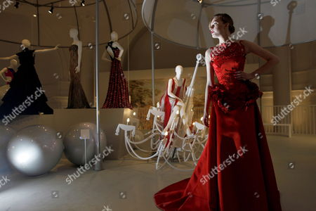Stock Picture of Model Zhanna Emelyanova Poses For a Photograph in a Red Silk Satin Ballgown From British Designer Giles Deacon's Current Collection During a Press Preview on the Launch of the Reopened Fashion Galleries of the Victoria and Albert Museum in London Britain 14 May 2012 the Exhibition 'Ballgowns: British Glamour Since 1950' Will Open in V&a's Renovated Fashion Galleries on 19 May It Will Feature More Than 60 Designs From the 20th and 21st Centuries United Kingdom London