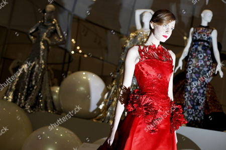 Stock Photo of Model Zhanna Emelyanova Poses For a Photograph in a Red Silk Satin Ballgown From British Designer Giles Deacon's Current Collection During a Press Preview on the Launch of the Reopened Fashion Galleries of the Victoria and Albert Museum in London Britain 14 May 2012 the Exhibition 'Ballgowns: British Glamour Since 1950' Will Open in V&a's Renovated Fashion Galleries on 19 May It Will Feature More Than 60 Designs From the 20th and 21st Centuries United Kingdom London