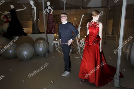 Model Zhanna Emelyanova (r) Poses For a Photograph in a Red Silk Satin Ballgown From the Current Collection of British Designer Giles Deacon (l) During a Press Preview on the Launch of the Reopened Fashion Galleries of the Victoria and Albert Museum in London Britain 14 May 2012 the Exhibition 'Ballgowns: British Glamour Since 1950' Will Open in V&a's Renovated Fashion Galleries on 19 May It Will Feature More Than 60 Designs From the 20th and 21st Centuries United Kingdom London
