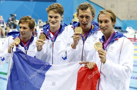 (l-r) French Team Members Clement Lefert Yannick Angel Amaury Leveaux and Fabien Gilot Celebrate After Winning the Gold Medal in the Men's 4x100m Freestyle Relay During the Swimming Competition Held at the Aquatics Center During the London 2012 Olympic Games in London England 29 July 2012 United Kingdom London