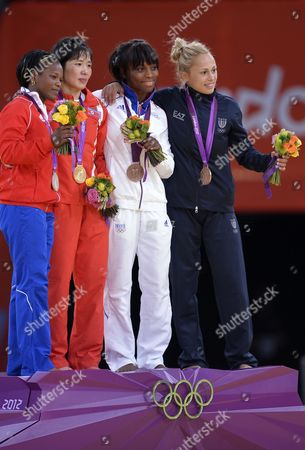 Kum Ae an of North Korea (2l Gold) and Yanet Beroy Acosta of Cuba (l Silver) Priscilla Gneto of France (2r Bronze) and Rosalba Forciniti of Italy (r Bronze) Pose During the Medal Ceremony of the Judo Women's -52 Kg at the London 2012 Olympic Games in London Britain 29 July 2012 United Kingdom London