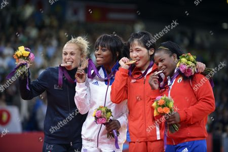 Kum Ae an of North Korea (2r Gold) and Yanet Beroy Acosta of Cuba (r Silver) Priscilla Gneto of France (2l Bronze) and Rosalba Forciniti of Italy (l Bronze) Pose During the Medal Ceremony of the Judo Women's -52 Kg at the London 2012 Olympic Games in London Britain 29 July 2012 United Kingdom London