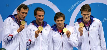 (l-r) French Team Members Amaury Leveaux Fabien Gilot Clement Lefert and Yannick Angel Celebrate After Winning the Gold Medal in the Men's 4x100m Freestyle Relay During the Swimming Competition Held at the Aquatics Center During the London 2012 Olympic Games in London England 29 July 2012 United Kingdom London