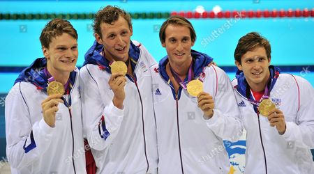(l-r) French Team Members Yannick Angel Amaury Leveaux Fabien Gilot and Clement Lefert Celebrate After Winning the Gold Medal in the Men's 4x100m Freestyle Relay During the Swimming Competition Held at the Aquatics Center During the London 2012 Olympic Games in London England 29 July 2012 United Kingdom London