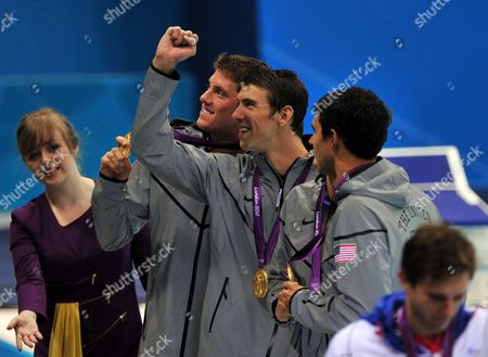 The Us Team with Ricky Berens (r-l) Ryan Lochte (hidden) Michael Phelps and Conor Dwyer Celebrate After Winning Gold in the Men's 4x200m Freestyle Relay Final During the London 2012 Olympic Games Swimming Competition London Britain 31 July 2012 United Kingdom London