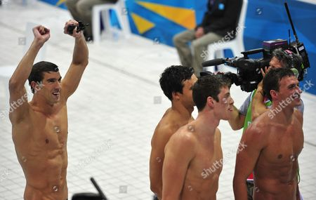 The Us Team with Michael Phelps (l-r) Ricky Berens Conor Dwyer and Ryan Lochte Celebrate After Winning Gold in the Men's 4x200m Freestyle Relay Final During the London 2012 Olympic Games Swimming Competition London Britain 31 July 2012 United Kingdom London