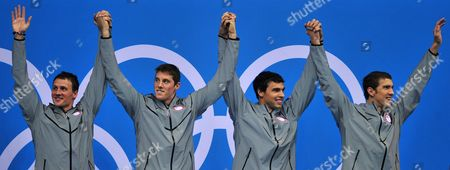 The Us Team with Michael Phelps (r-l) Ricky Berens Conor Dwyer and Ryan Lochte Celebrate After Winning Gold in the Men's 4x200m Freestyle Relay Final During the London 2012 Olympic Games Swimming Competition London Britain 31 July 2012 United Kingdom London