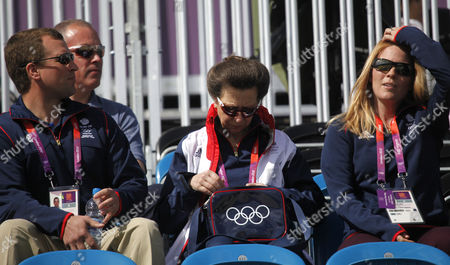 Princess Anne of Great Britain (c) Goes Through Her Olympic Handbag Next to Her Son Peter Philips (l) and His Wife Autumn (r) in the Stands in Greenwich Park Equestrian Stadium During the London 2012 Olympic Games Equestrian Eventing Competition in Greenwich Park Southeast London Britain 29 July 2012 United Kingdom London