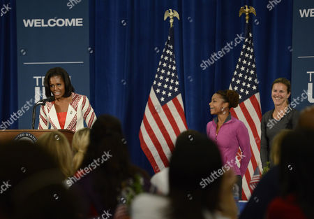 United States First Lady Michelle Obama (l) Address the 2012 Team Usa As Former Olympians Dominique Dawes Artistic Gymnast (c) and Brandi Chastain (r) Soccer Look on at the U S Olympic Training Facility University East London in London England 27 July 2012 United Kingdom London