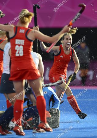 Laura Bartlett of Great Britain (r) and Nicola White (l) Celebrate After Teammate Alex Danson Scored Against Japan During Women's Field Hockey at Olympic Park Riverbank Arena at the London 2012 Olympic Games Field Hockey Competition London Britain 29 July 2012 United Kingdom London