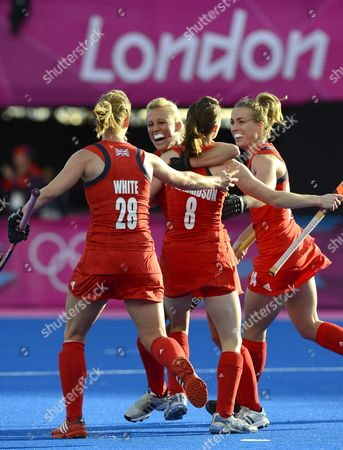 Alex Danson of Great Britain (left-c) Celebrates with Teammates Helen Richardson (c) Laura Bartlett (r) and Nicola White (l) After Danson Scored Against Japan During Women's Field Hockey at Olympic Park Riverbank Arena at the London 2012 Olympic Games Field Hockey Competition London Britain 29 July 2012 United Kingdom London