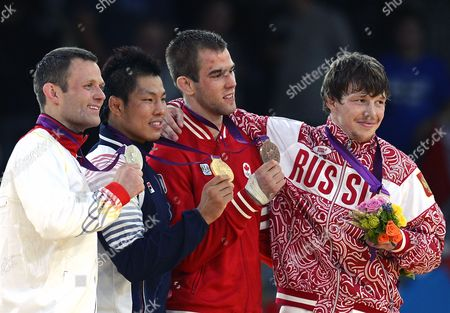 Gold Medalist Kim Jae-bum (2nd L) of South Korea is Flanked by Silver Medalist Ole Bischof (l) of Germany and Bronze Medal Winners Antoine Valois Fortier (2nd R) and Russia's Ivan Nifontov (r) During the Medal Ceremony For the Men's -81kg Final at the London 2012 Olympic Games Judo Competition London Britain 31 July 2012 United Kingdom London